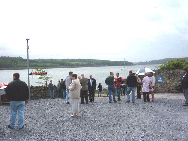 A reunion group look out at the Menai Straits