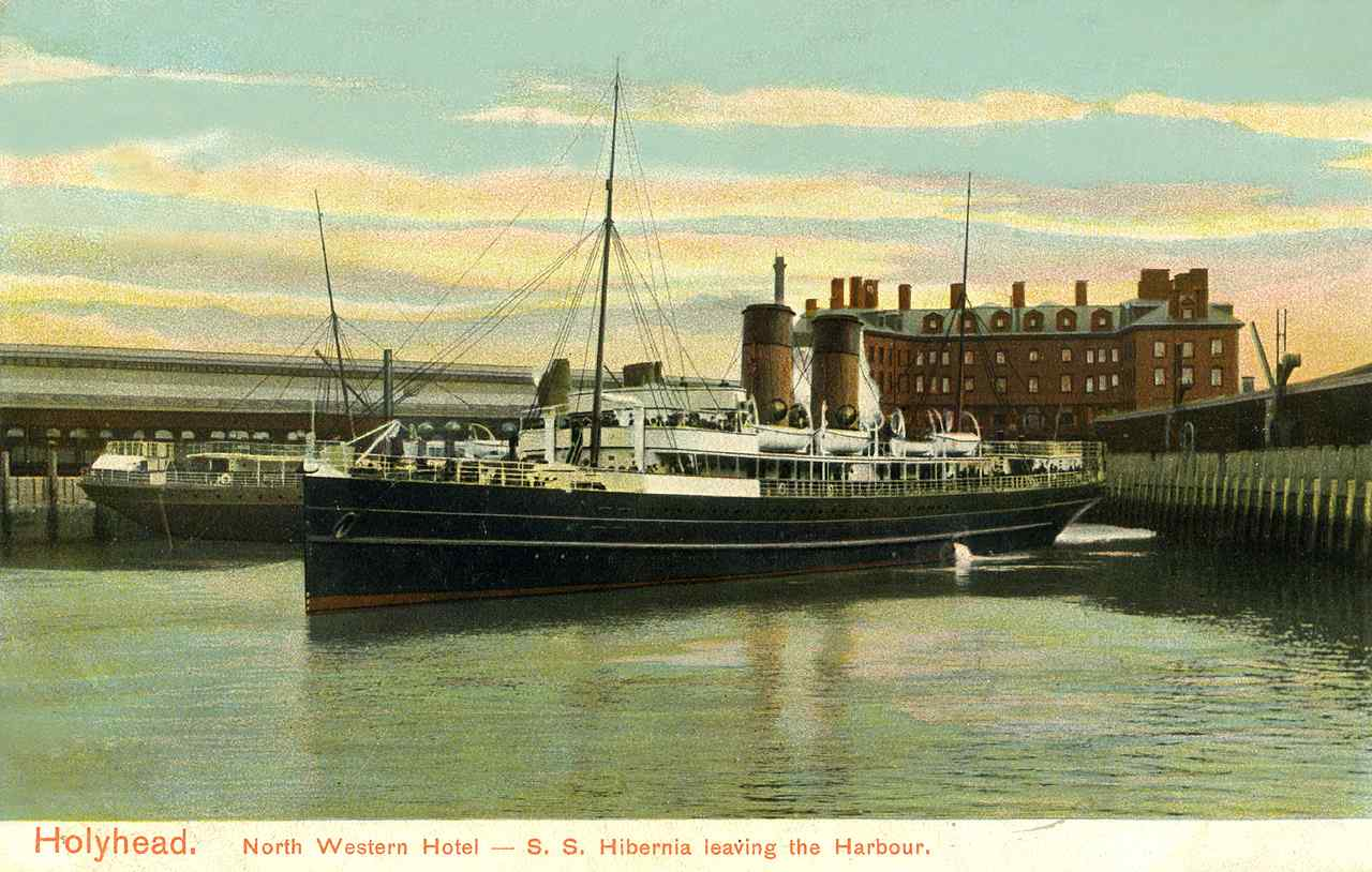 holyhead, the ss hibernia later renamed hms tara leaving the harbour c.1905