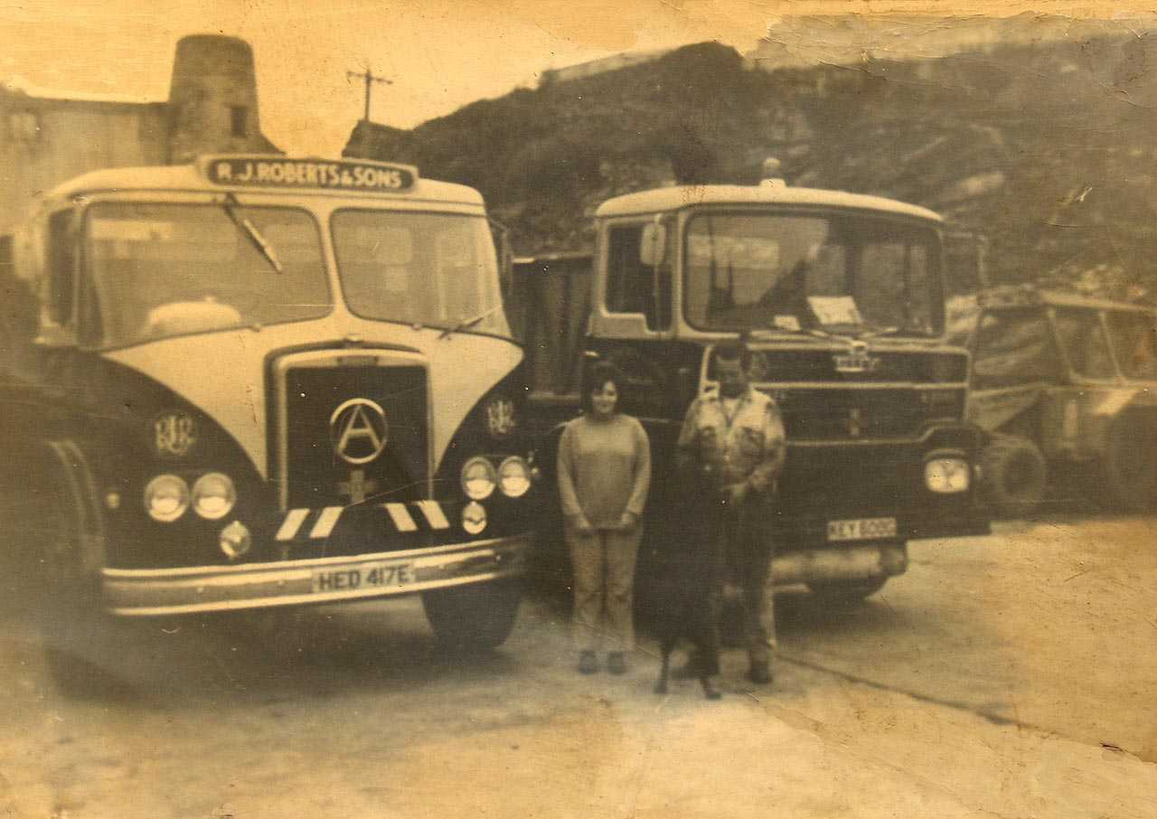 Anglesey, Holyhead, R.J. Roberts & Sons Haulage, John and Liz Roberts with Melin Tan Refail Windmill in the background early 1970's