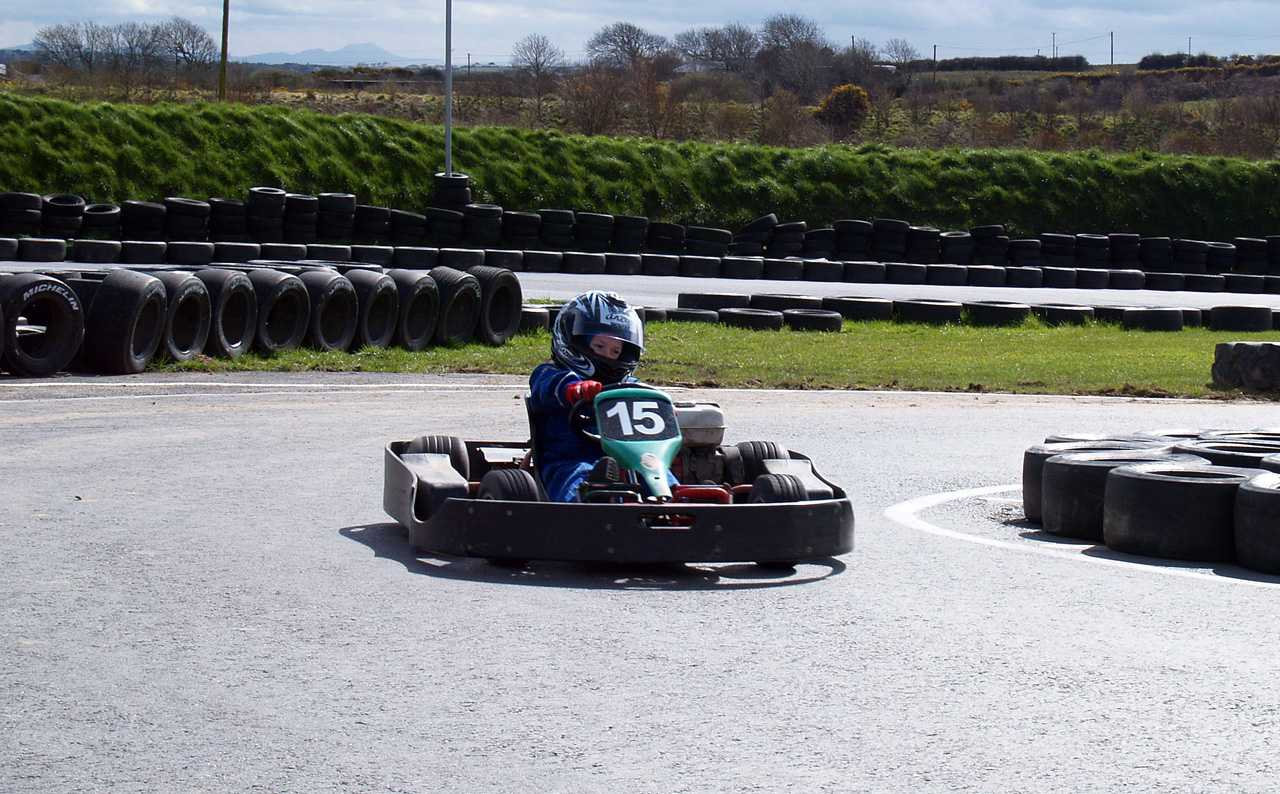 Taking a coener at speed in a gokart