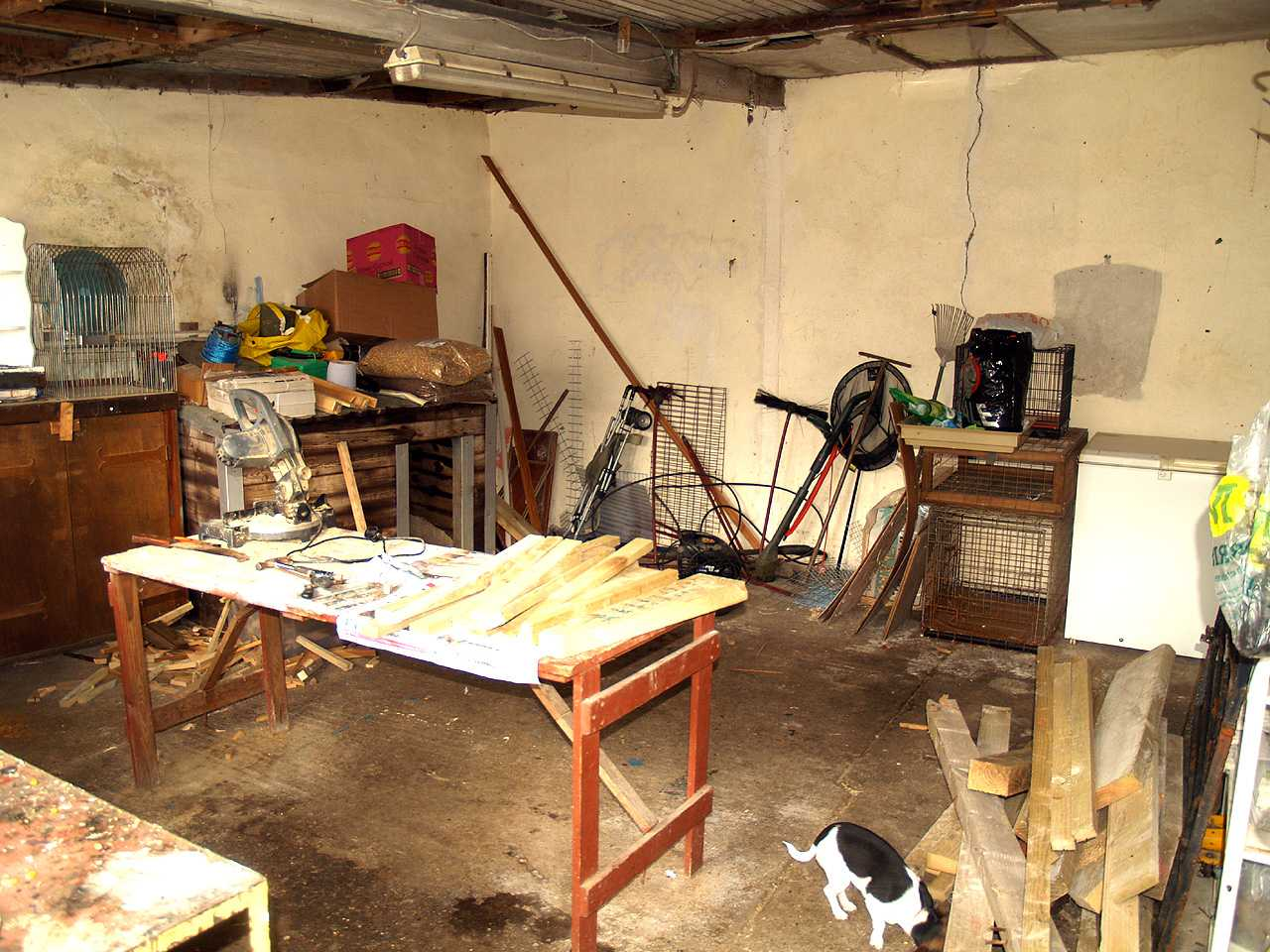 Workshop interior to rear of house for sale in Holyhead