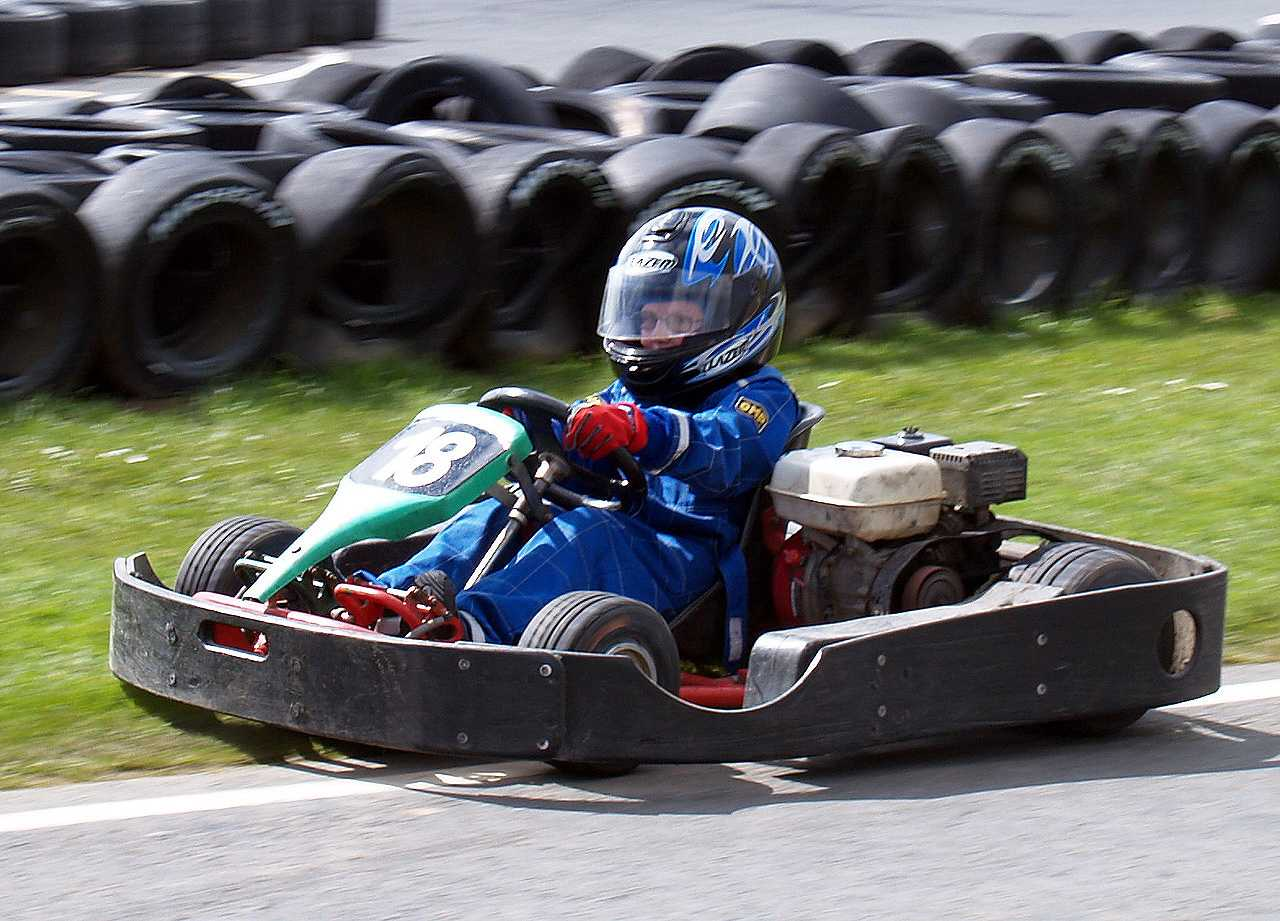 A young racer spins onto the grass