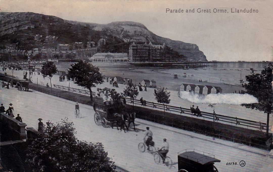 llandudno, parade and great orme with vintage horse drawn carriage and tourists