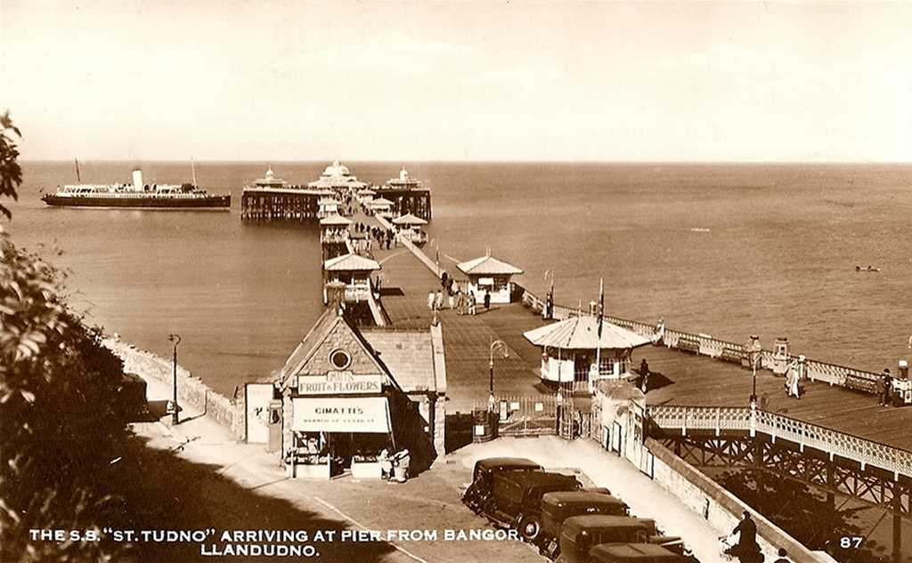 llandudno, st tudno arriving at the pier from bango old photor