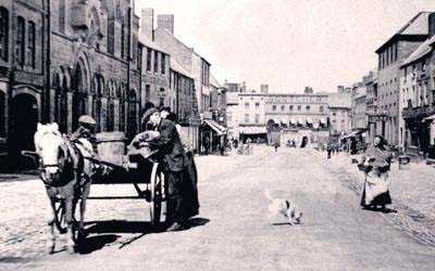 Holywell High Street with vintage horse and cart