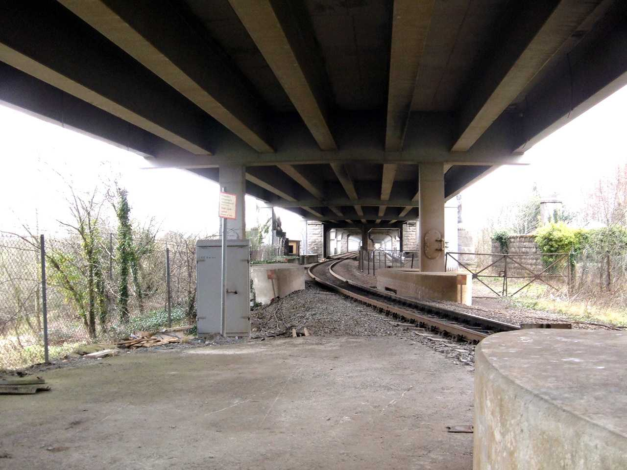 The original (and still used) rail line passing under the road