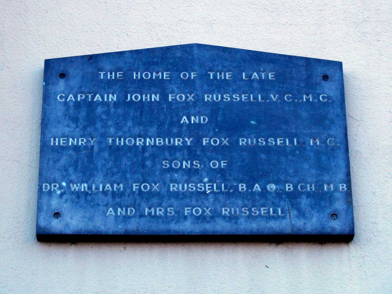 Plaque commemorating Captain John Fox-Russell and Captain Henry Thornbury Fox-Russell outside their home