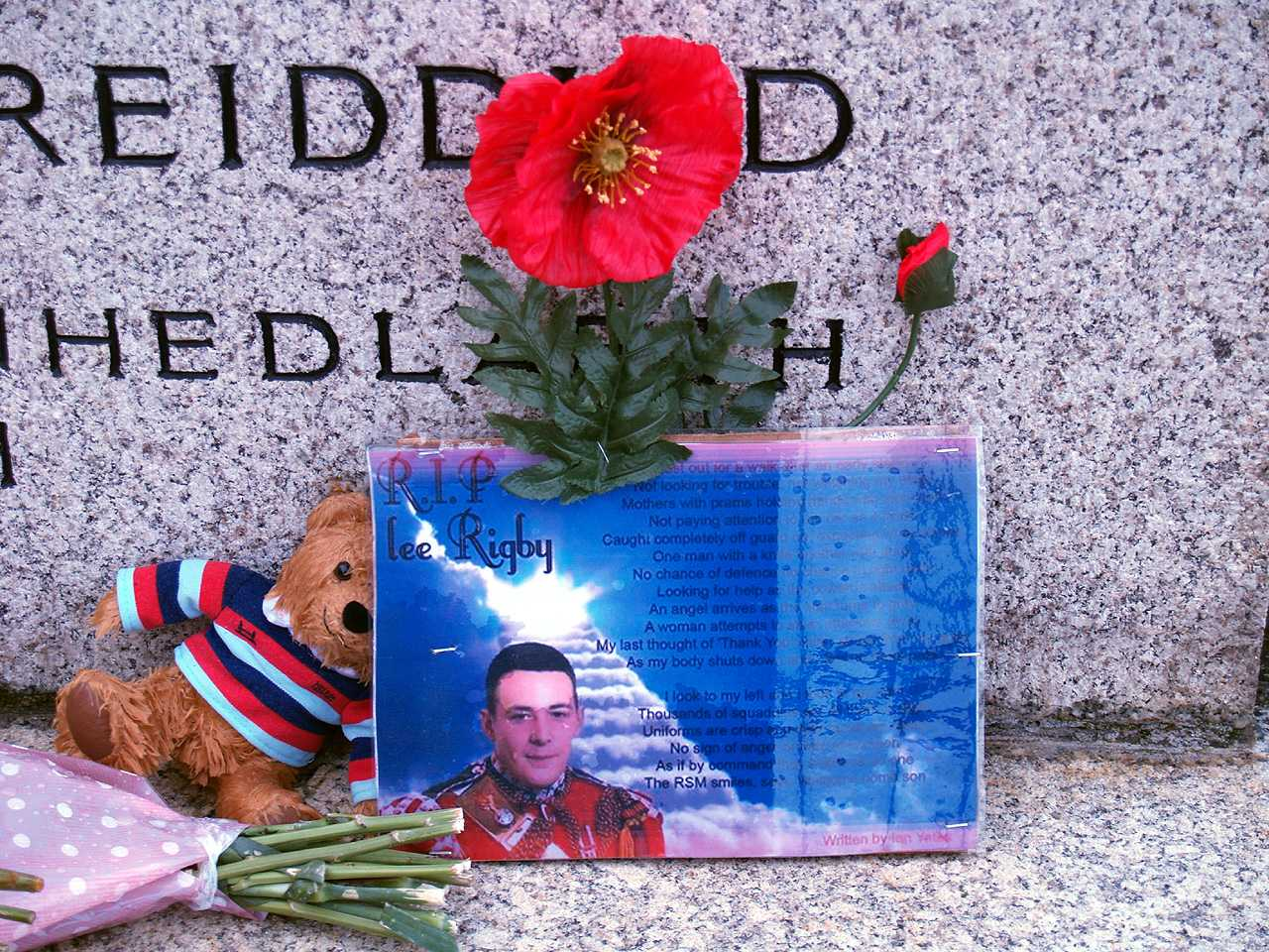 Holyhead pays tribute at the War Memorial - a photo of Lee James Rigby, a poppy and a little cuddly bear all left in tribute