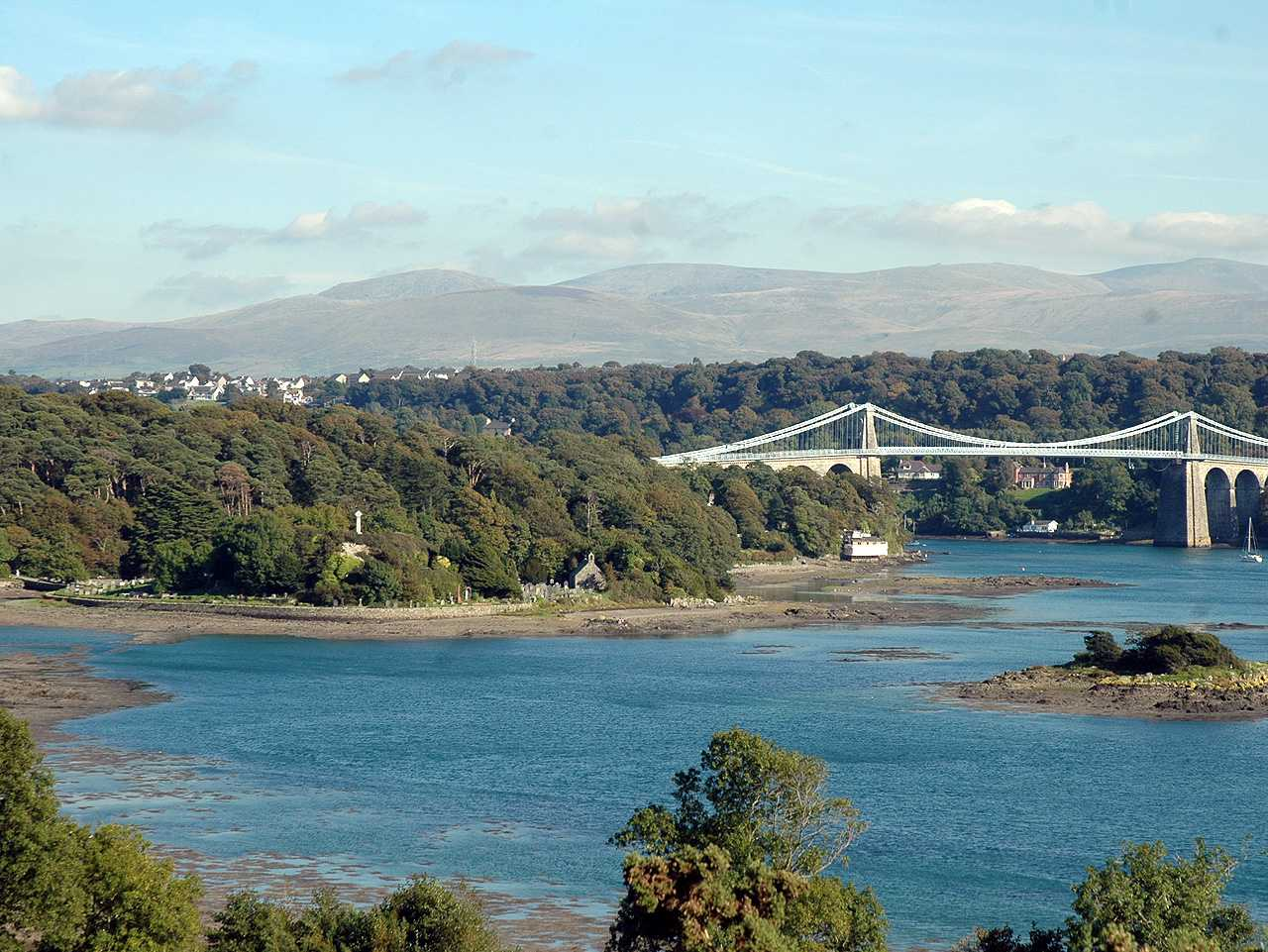 Anglesey, Menai Bridge, The War Memorial can be clearly seen to the left of the Church