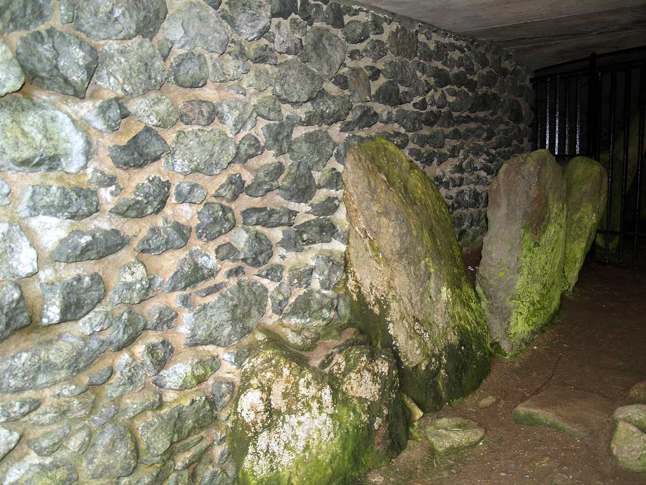Anglesey, Llanfaelog, Barclodiad-y-Gawres Burial Chamber - ancient standing stones line the entrance to the chamber